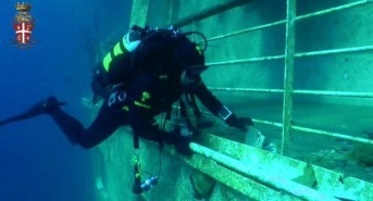 Police release footage of divers on the sunken Costa Concordia – watch video
