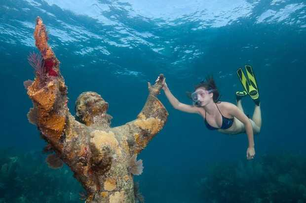 Want to get married underwater with Christ as your witness? Amoray Dive Resort can make it happen