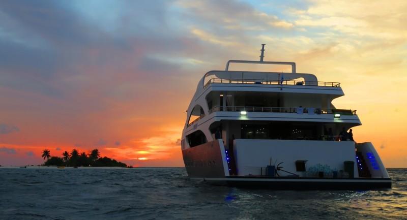 0916-Serenity-boat-at-sunset-on-ocean-e1491172286613.jpg